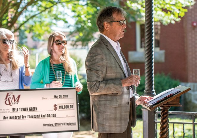 BERNADINE HERNANDEZ/SALISBURY POST Dyke Messinger thanks F&M  bank for their donation of $110, 000 to the Bell Tower green park Salisbury, N.C. 6/11/19